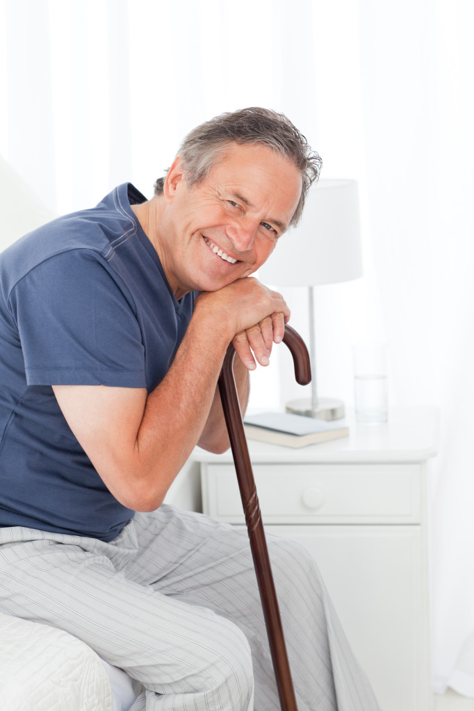 Retired man with his walking stick